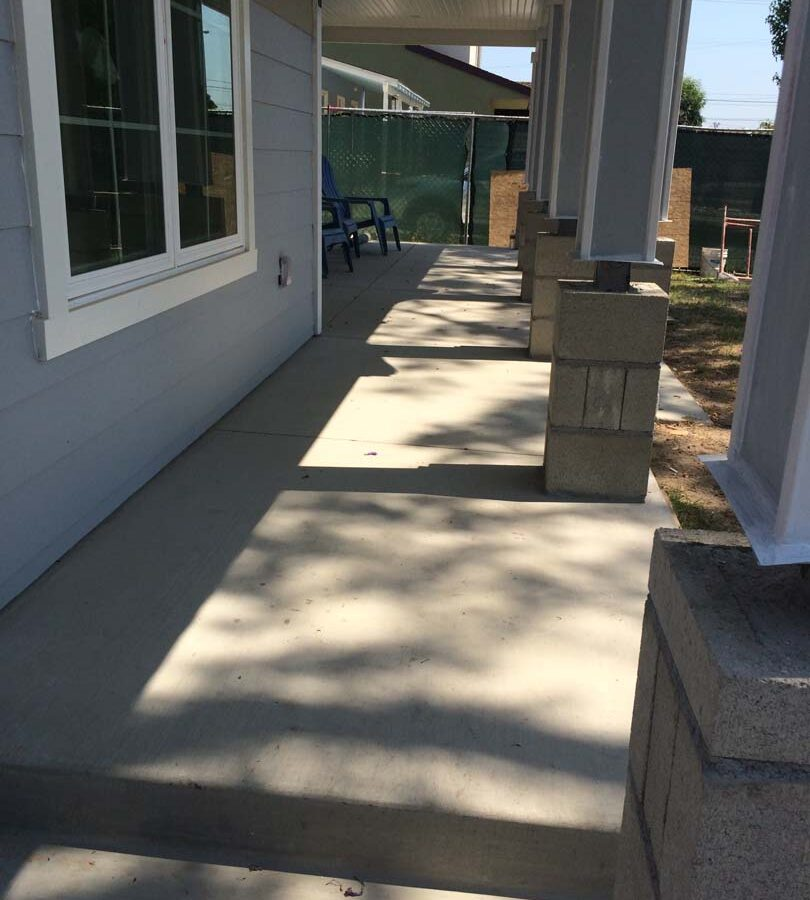 The owner of this home wanted to cover their pilasters at the bottom of each post with stone veneer and install new flagstone over the concrete. We helped them build this upgrade to their home. Pacificland Constructors