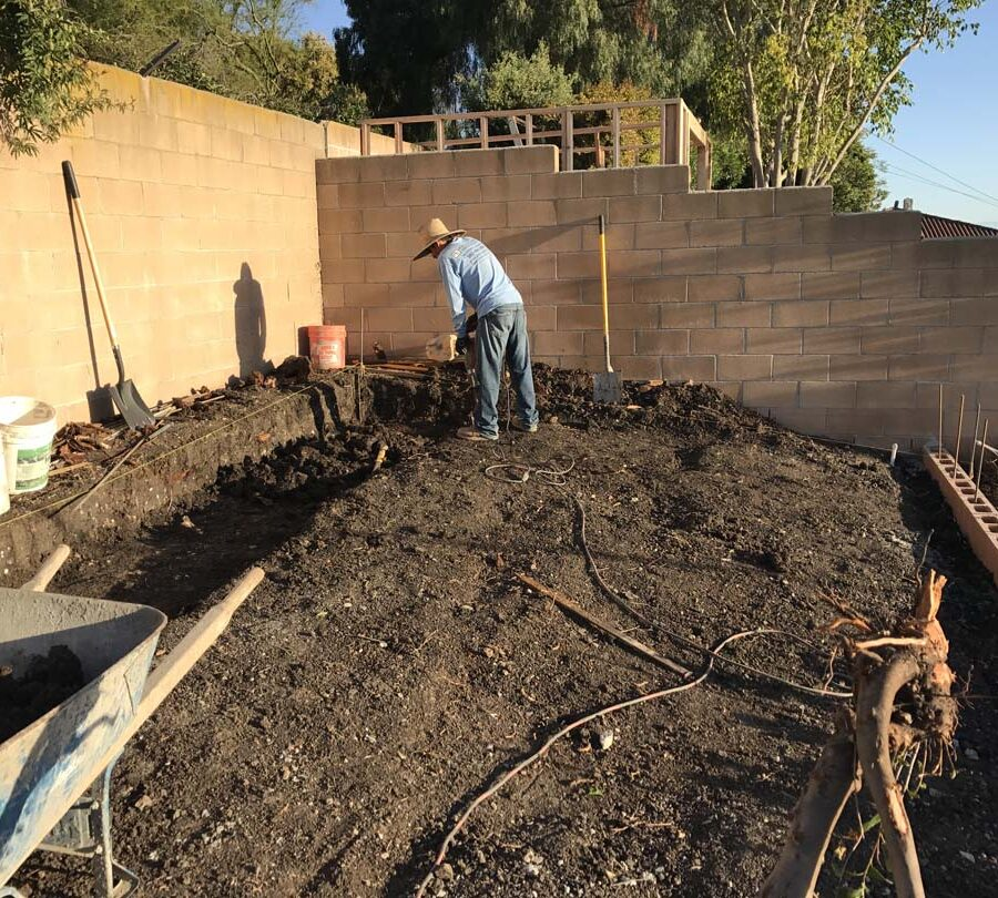 Excavation of dirt where pavers are going to be installed. Pacificland Constructors