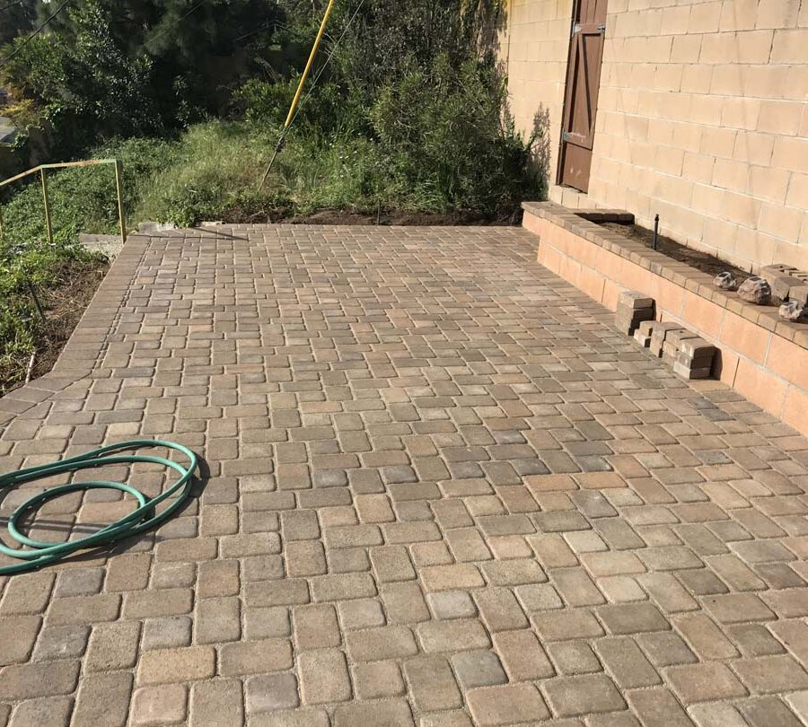 View of the paver patio. Pacificland Constructors.