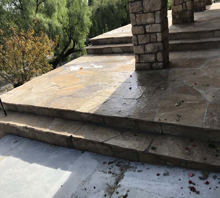 Stone veneered pilasters and walls that match flagstone flatwork for a home's porch in San Pedro, CA. Pacificland Constructors