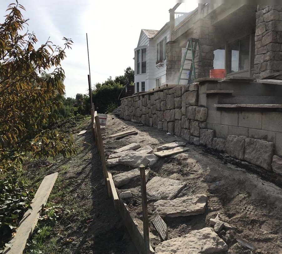 Construction of stone veneered cmu walls and pilasters that will match flagstone flatwork selected by the owner for their home's porch. Pacificland Constructors