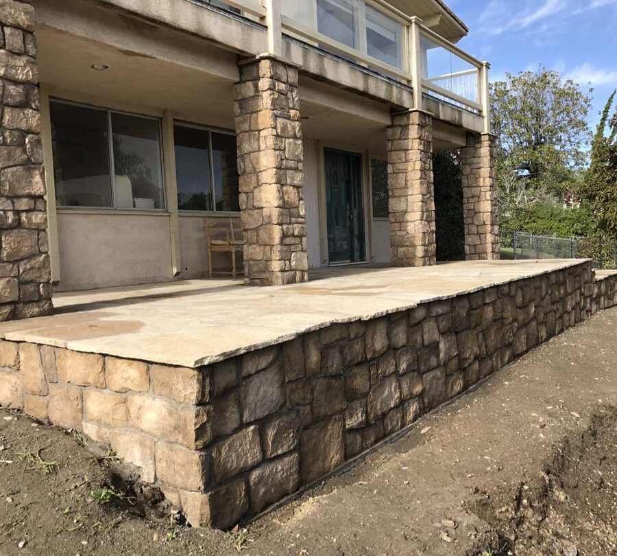 Stone covered pilasters and walls that match flagstone flatwork. Pacificland Constructors