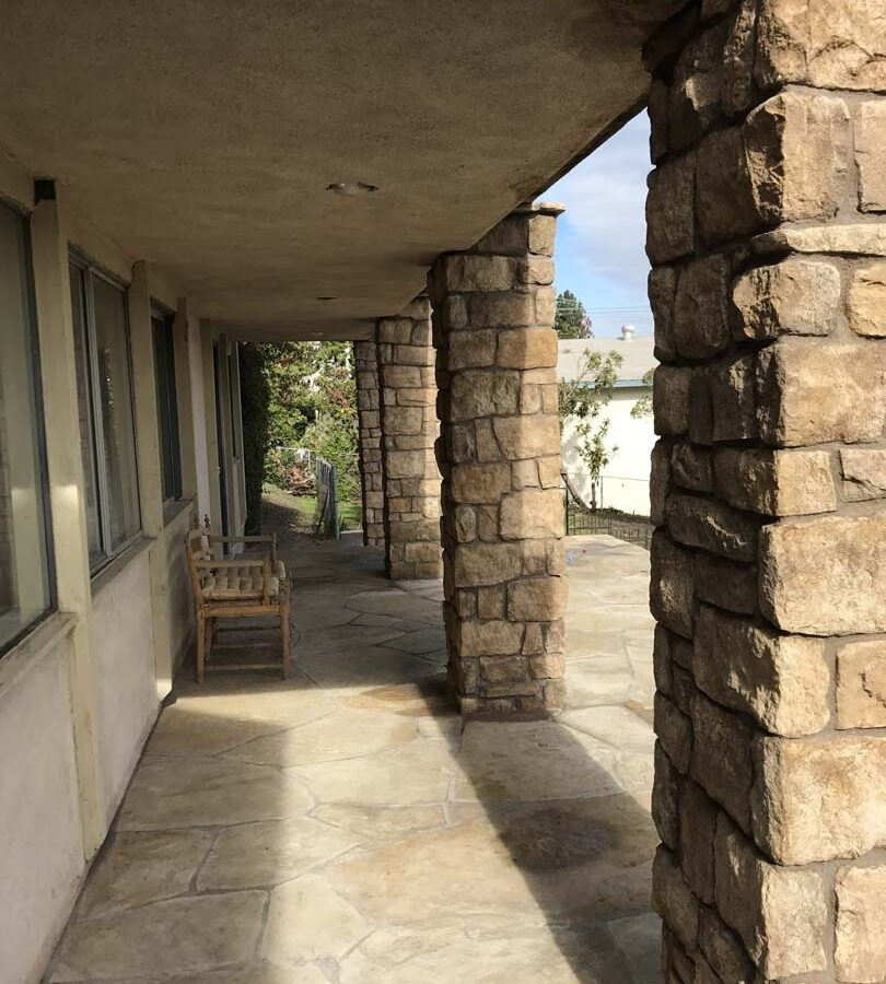 Stone veneered pilasters that match flagstone flatwork. Pacificland Constructors