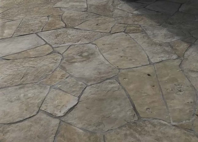 Stone veneered pilasters and walls that match flagstone flatwork. Pacificland Constructors