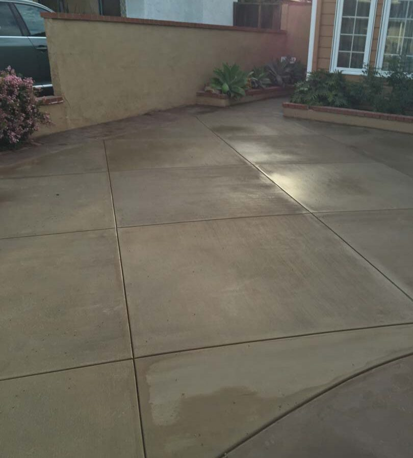 New colored concrete driveway for a residential home. Pacificland Constructors