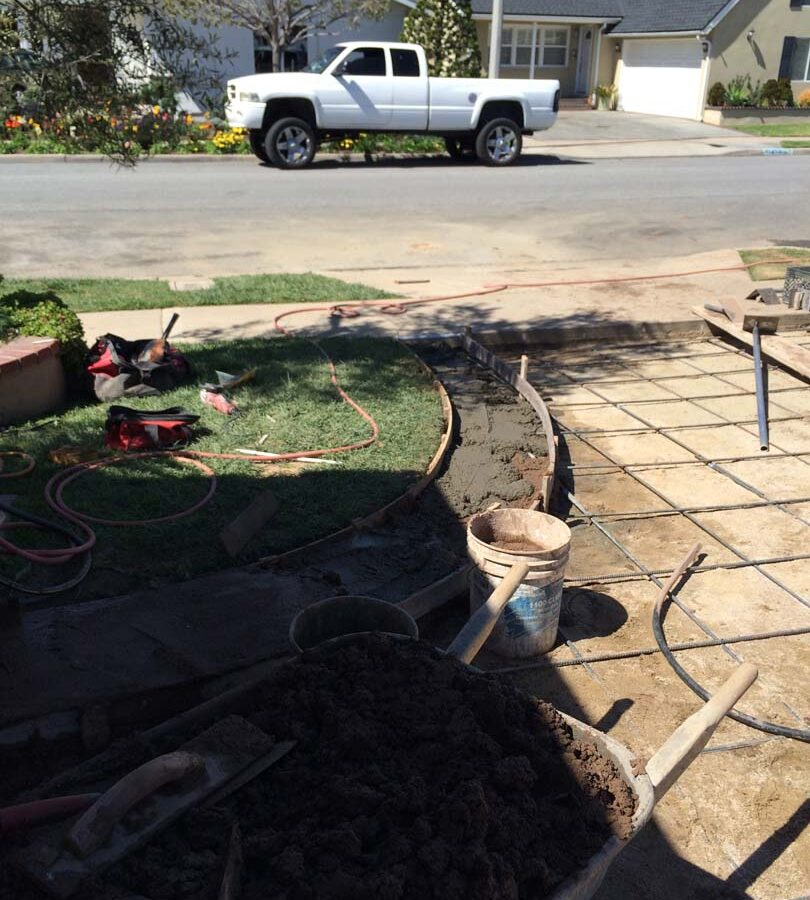 Steel reinforcement for a new colored concrete driveway. It will have a diamond pattern and a contrasting ribbon around the perimeter. The surface will be broom swept and have hand scorched joints. Pacificland Constructors